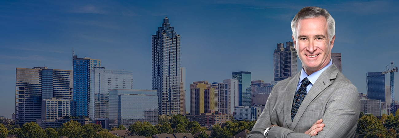 Hero Banner - Attorney Picture over skyline of Atlanta